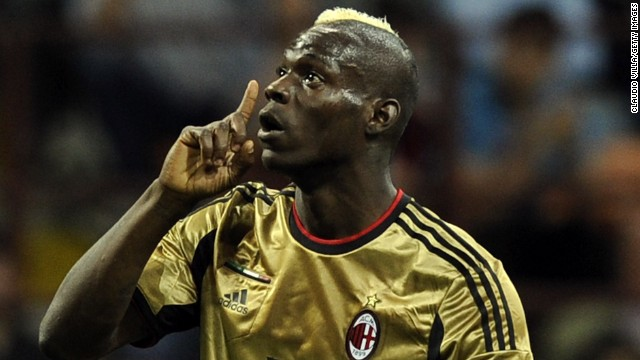 AC Milan's Mario Balotelli reacts to racist abuse from the visiting Roma fans at the San Siro in May. It was not the first time the Italian-born striker has been racially abused in Serie A.
