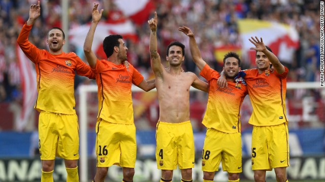 The Barcelona players celebrated a fourth title in five seasons, and 22nd overall -- which was secured when second-placed Real Madrid could only draw with Espanyol the previous day.