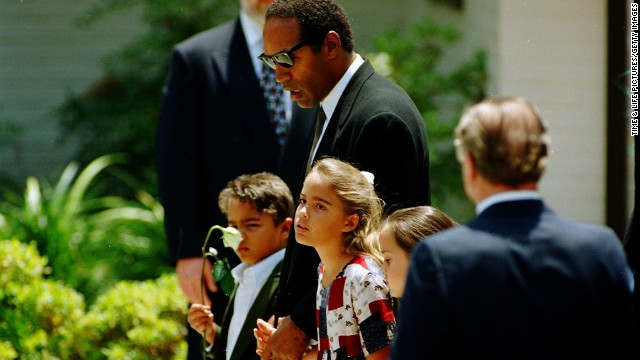 Simpson and children attend Nicole Brown Simpson's funeral in June 1994.