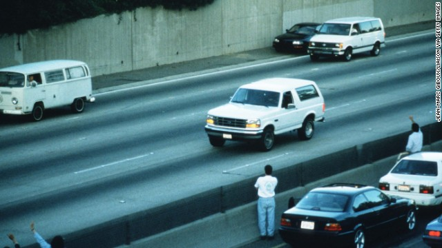 In footage seen on TV screens around the world, police chase a white Ford Bronco with a fugitive Simpson on the Los Angeles freeways on June 17, 1994. The Bronco eventually returned to Simpson's home in the Brentwood section of Los Angeles, and he surrendered to police on murder charges in the deaths of his ex-wife and Ronald Goldman.