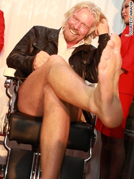 The beard can stay, but the leg hair has to go. Branson had his legs shaved at a cocktail party the night before the flight.