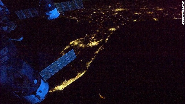 "A view of the <a href='https://twitter.com/Cmdr_Hadfield/status/333660605984677888' target='_blank'>Florida Peninsula</a> at night. ""Spaceship's glowing blue in the dawn,"" wrote Hadfield on May 12, ""as we leave Florida headed across the Atlantic."""