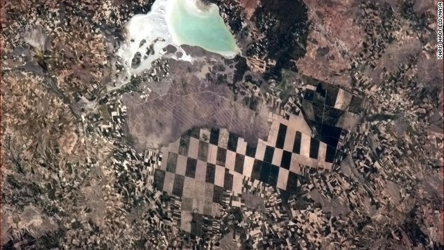 "A <a href='https://twitter.com/Cmdr_Hadfield/status/332215204224057344' target='_blank'>checkerboard scene</a> below. ""Little farmers, big farmers and nature, in Turkey,"" Hadfield wrote on May 8."