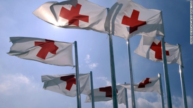 (File photo) Red Cross flags flutter in the wind on June 26, 2009 at the International Red Cross humanitarian camp in Italy.