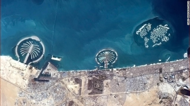 """Some of the things we build for ourselves are puzzlingly visible from space,"" wrote Hadfield, referring to <a href='https://twitter.com/Cmdr_Hadfield/status/314506287092224000' target='_blank'>manmade islands in Dubai</a> as seen on March 20."