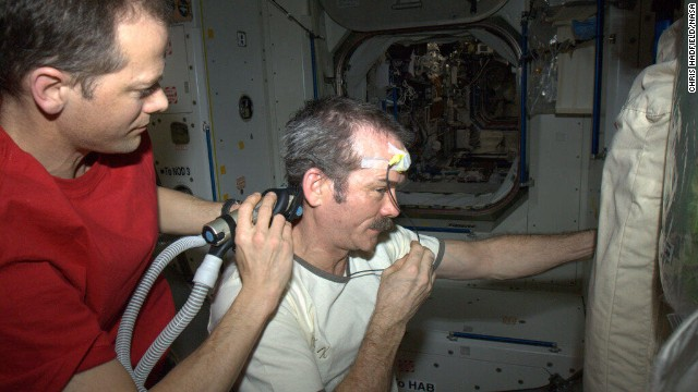"Hadley got a <a href='https://twitter.com/Cmdr_Hadfield/status/320960647728873473' target='_blank'>space haircut</a> as depicted in this April 7 photo. ""Dr. Tom doing a nice, surgical job of trimming, working around the science experiment (temperature) sensor,"" Hadfield tweeted."