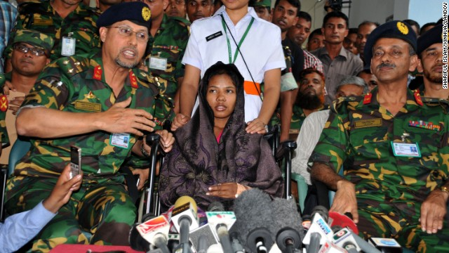 Begum is surrounded by media and members of the Bangladeshi military at the hospital where she is recovering in Dhaka on May 13.