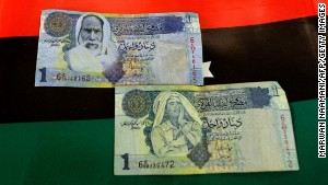 Forged notes subbing Moammar Gadhafi\'s image (bottom) with that of Omar Mukhtar have now been replaced with legitimate new one-dinar notes.