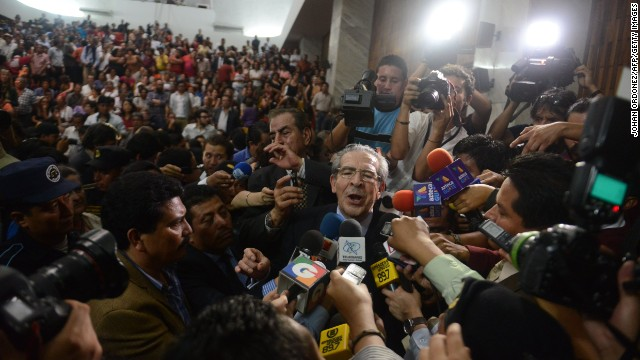 "Former Guatemalan dictator Efrain Rios Montt talks to the media in Guatemala City, on May 10, 2013, after being convicted on charges of genocide allegedly committed during his regime. It was ""the first time, anywhere in the world,"" that a former head of state was being tried for genocide by a national tribunal, according to the United Nations. The conviction was overturned 10 days later."