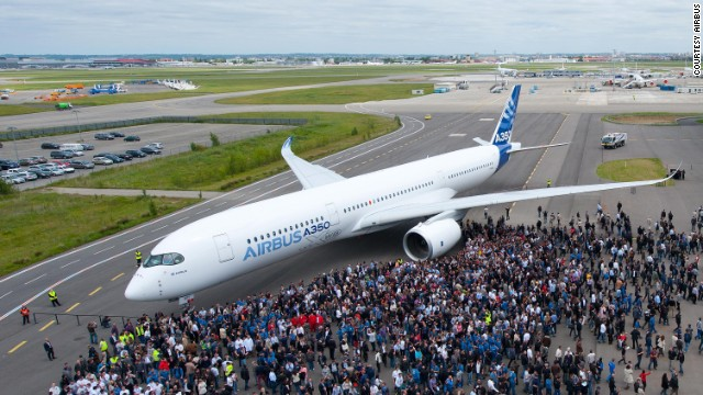 Who's a pretty boy then? Airbus' first completed A350 XWB is unveiled with a full paint-job in Toulouse, France on May 13. The plane is set to rival Boeing's 787 Dreamliner in the mid-size aircraft market.