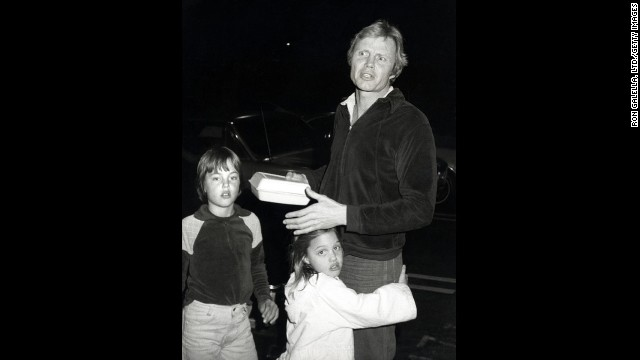 Jolie, center, hugs her father, Jon Voight, in Los Angeles in 1980. Her brother, James, is at left.