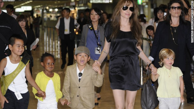 Jolie walks with four of her children -- Maddox, from left, Zahara, Pax and Shiloh -- at Japan's Narita International Airport in July 2010.