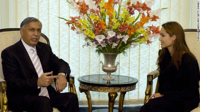 Jolie speaks with Pakistani Prime Minister Shaukat Aziz in Islamabad, Pakistan, in May 2005 as part of her role as goodwill ambassador for UNCHR.