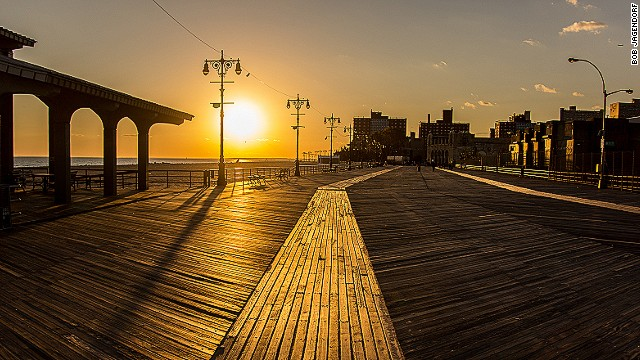 The first boardwalk was built in Atlantic City in 1870, when a railroad conductor was asked to find a way to prevent sand from filling shorefront hotel entryways. Coney Island (pictured) in New York also includes roller coasters, carnival attractions and other slices of Americana.