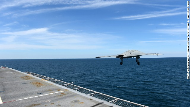 An X-47B Unmanned Combat Air System demonstrator leaves the flight deck of the aircraft carrier USS George H.W. Bush on Tuesday, May 14. The drone, propelled by a catapult, was the first to be launched from an aircraft carrier.