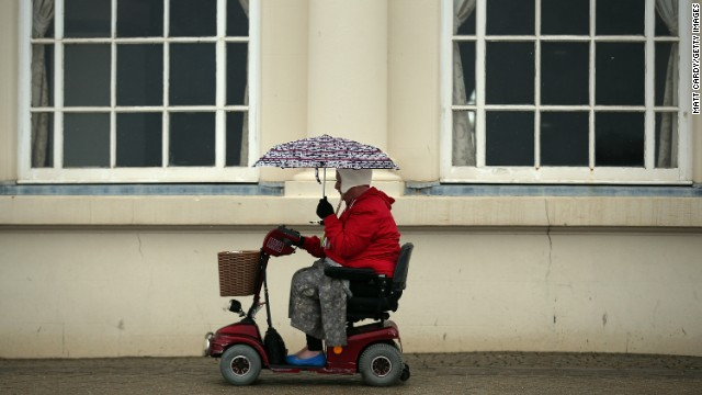 A woman passes along the seafront as the rain falls in Weston-Super-Mare, England, on Tuesday, May 14. Click through to see other images of weather around the world: