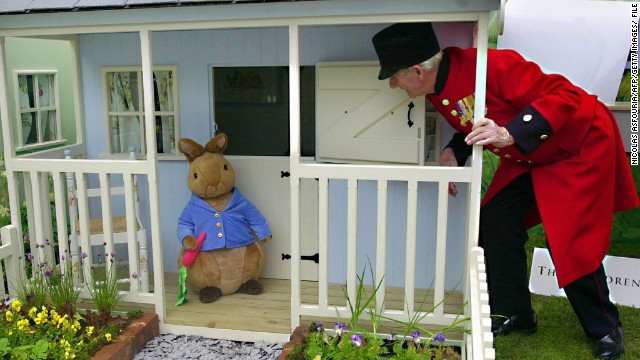 In their distinctive red coats, old soldiers called Chelsea Pensioners are a familiar sight at Chelsea. Here, one comes face to face with the Beatrix Potter character Peter Rabbit, in 2003.