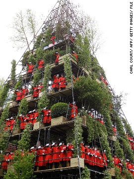 "Garden designer Diarmuid Gavin created an 80ft pyramid-shaped ""Westland Magical Garden'"" in 2012. He asked Chelsea Pensioners, retired soldiers who live in the Royal Hospital Chelsea, to pose for pictures on the pyramid."