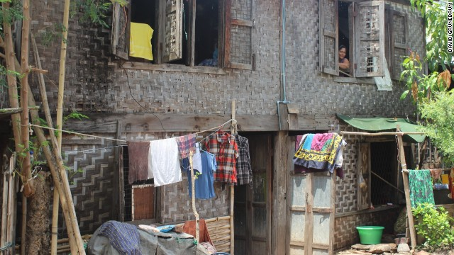 They family's modest home survived the unrest, while thousands of other homes were burned to the ground.