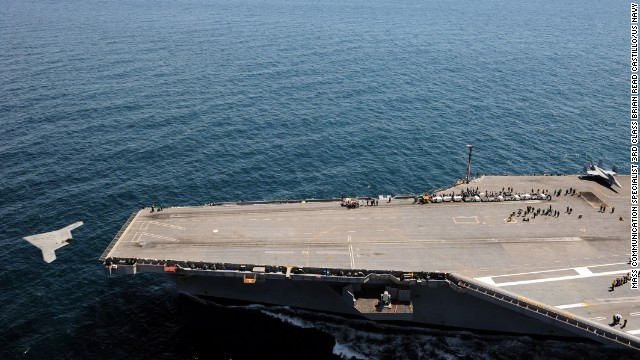 The U.S. aircraft carrier George H.W. Bush successfully catapult launches an unmanned aircraft from its flight deck for the first time. Analysts argue that drone technology poses a serious threat to carriers as a viable weapon of war.
