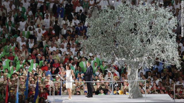 Addressing the world at the opening ceremony of Athens 2004, Angelopoulos is accompanied by IOC President Jacques Rogge.