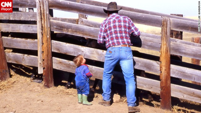 To this day, blue jeans remain the uniform for cowboys young and old. Here, Bruce Beasley and his grandson <a href='http://ireport.cnn.com/docs/DOC-971568'>load cattle on their farm</a> in Patricia, Alberta, in May 2013.