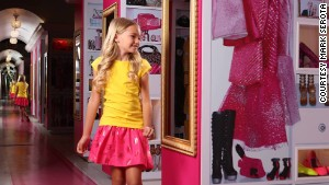 Barbie\'s pink digs display her extensive wardrobe and an apparent shopping addiction.