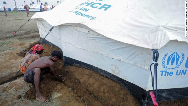 Displaced Rohingyas dig a drainage ditch around a relief tent at the Ohnedaw camp on the outskirts of Sittwe on May 15. Rohingya people are a stateless Muslim minority who suffered during decades of military rule in Myanmar.