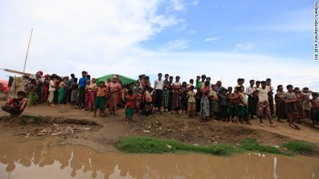 Thandawli villagers stand by the bank of a river in a displacement camp outside Sittwe on Tuesday, May 14.