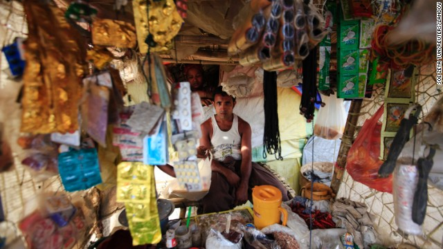 A man sits inside a tent that he has turned into a makeshift shop at a displacement camp for Muslims outside Sittwe on May 13.