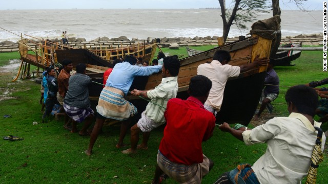 Bangladeshis pull a boat away from a beachfront in Chittagong on May 16 as Tropical Cyclone Mahasen approached.