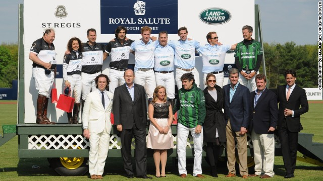 Competitors and attendees of the 2013 <a href='http://sentebale.org/polo-cup-to-take-place-in-greenwich-connecticut-2013/' target='_blank'>Sentebale Royal Salute Polo Cup</a> pose for a photo with Prince Harry, back row center, at the Greenwich Polo Club.
