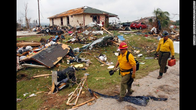 Rescue personnel pass remnants of destroyed houses in Granbury on May 16. There were reports of homes in Granbury being flattened with people inside.