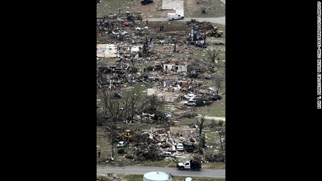Debris from damaged homes litters a neighborhood in Granbury on Thursday, May 16.