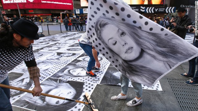 French street artist JR started <a href='http://www.insideoutproject.net/en' target='_blank'>the Inside Out project</a> in 2011. He invites people around the world to submit portraits, share a statement about what they stand for and paste large-format prints in public spaces. The project has distributed more than 130,000 posters in over 100 countries. Pictured: New York, 2013.