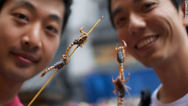 "Although scorpions aren't technically 'insects,' they still made it onto the U.N. report. They're more of a tourist draw than conventional Chinese cuisine, and can be found at <a href='http://travel.cnn.com/shanghai/life/5-extreme-foods-at-beijing-night-market-294439'>street stalls dotting Beijing's major shopping street of Wangfujing</a>. ""They taste like anything deep-fried -- crunchy and oily but no real flavor,"" says Soon Ho Lee, one of the adventurous tourists in this photo (left)."