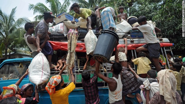 Families load their belongings onto a truck before returning to a temporary relief camp at a mosque in Thetkaepyin, Myanmar, on May 17.