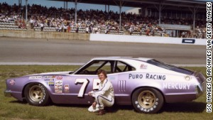 Dick Trickle poses with his Mercury racing car at Daytona International Speedway in February 1975.