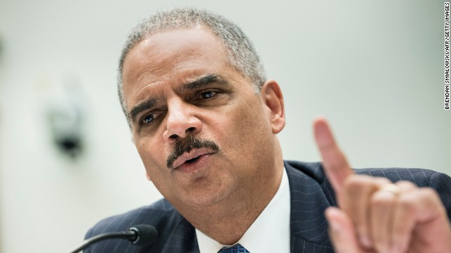 U.S. Attorney General Eric Holder testifies during a hearing of the House Judiciary Committee on Capitol Hill on Wednesday, May 15 in Washington. The day before, Holder announced a Justice Department investigation into any possible criminal wrongdoing by the IRS.