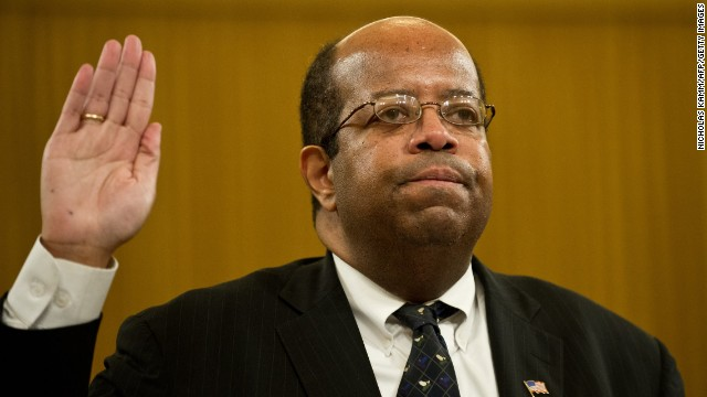 Treasury Inspector General for Tax Administration J. Russell George is sworn in before testifying in Washington in May 2013. According to his report, the IRS developed and followed a faulty policy for determining whether applicants were engaged in political activities, which would disqualify the groups from receiving tax-exempt status.