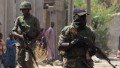 This picture taken on April 30, 2013 shows Nigerian troops patrolling in the streets of the remote northeast town of Baga, Borno State. Nigeria's military said on May 16, 2013 that it was ready to launch air strikes against Boko Haram Islamists as several thousand troops moved to the remote northeast to retake territory seized by the insurgents. A force of 