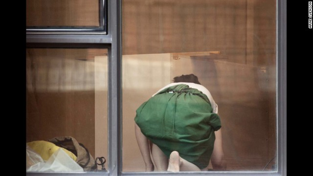 "This photo, ""The Neighbors #5,"" 2012, from photographer Arne Svenson's series, ""The Neighbors,"" is one of several being exhibited at <a href='http://www.saulgallery.com/' target='_blank'>Julie Saul Gallery</a> in New York."