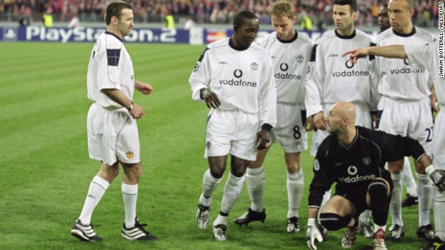 Karl Power, a Manchester United supporter, became an instant legend when he managed to sneak into Manchester United's pre-game team photo.