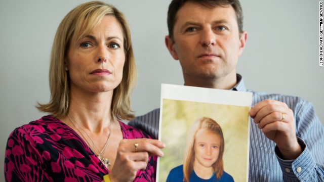 Kate and Gerry McCann pose with an artist's impression of how their daughter Madeleine now.