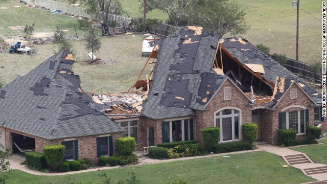 A heavily damaged home can be seen in this aerial view on Thursday, May 16, in Cleburne, Texas.