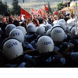 People from Reyhanli, Turkey, chant slogans as riot police block their path on May 18, 2013, during the funerals of victims of a car bomb which went off on May 11.