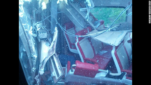 Debris and twisted metal is seen inside one of the derailed trains on May 17.