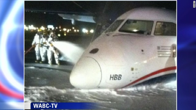 This image from WABC-TV shows emergency crews hosing down the plane with foam.
