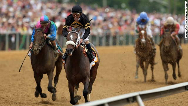 Stevens and Oxbow hold off itsmyluckday, ridden by John Velazquez, at the finish line to win the Preakness Stakes.