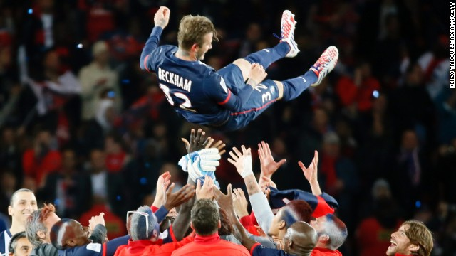 Beckham's teammates lift him high after their 3-1 win over Brest in the Parc des Princes.